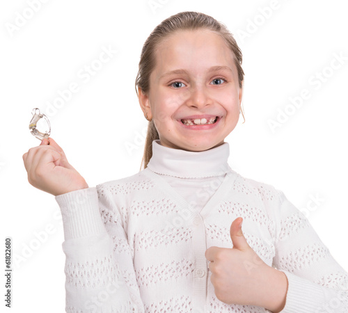 Girl holding dental braces