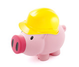 Piggy bank protected with hard hat isolated on white
