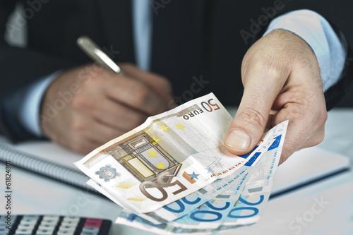 Leinwandbild Motiv Foreground lifestyle businessman in suit and tie