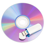 cd disks and flash drive on white background