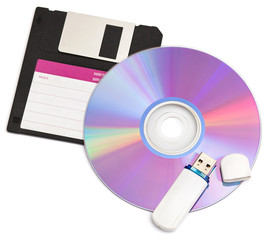 cd disks floppy and flash drive on white background