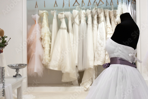 The range of wedding dresses on hangers and on a mannequin in th