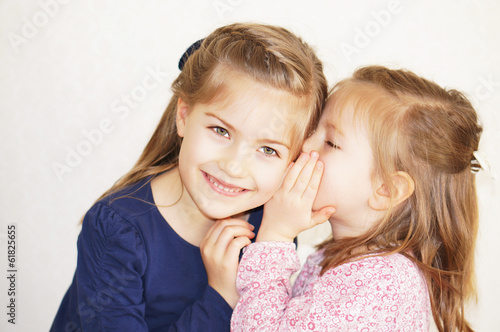 sister girls whisper in ear