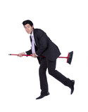 Businessman flying a broom