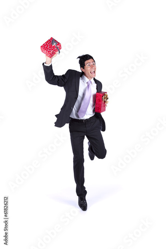 Happy businessman with christmas presents