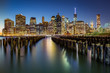 Lower Manhattan and an old Brooklyn pier at dusk