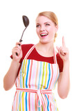Funny housewife cook chef in colorful kitchen apron with ladle