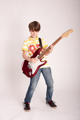 Teenager loves electric guitar