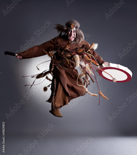 Studio shot of angry shaman posing in jump