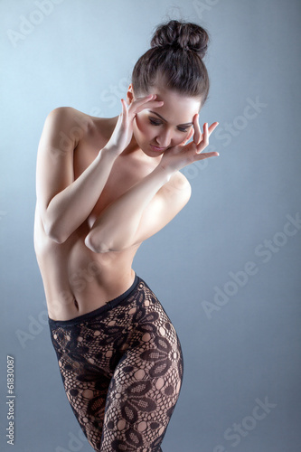 Sensual naked model posing in fancy pantyhose