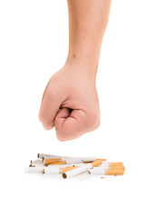 Man's fist crushing cigarettes isolated on white background