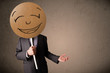 Businessman holding a smiley face board