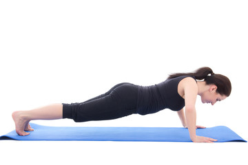 young sporty woman doing push up exercise isolated on white