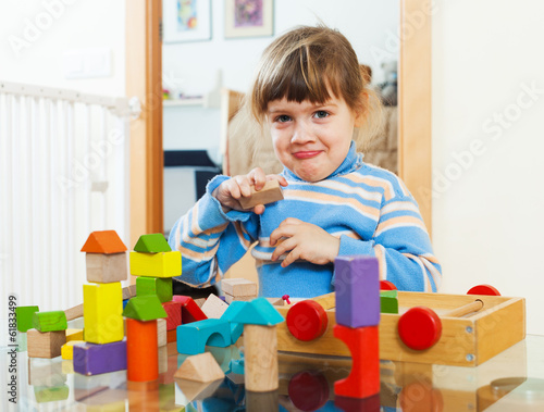 3 years child playing with toys in home