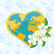 Planet earth in  heartsform with spring flovers on flowers backg