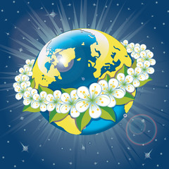 Planet earth with wreath of spring flovers.View from space