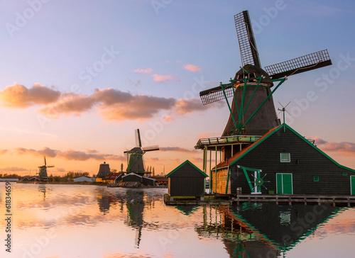 Foto op Aluminium Amsterdam Traditional Dutch windmills with canal near the Amsterdam, Holla