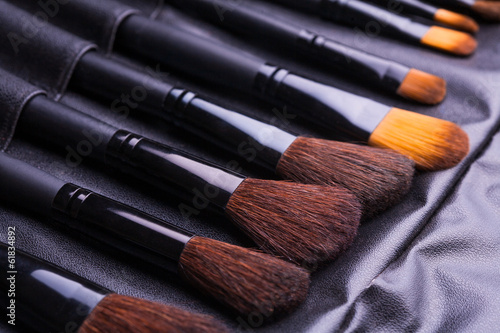 Set of black make-up brushes in row