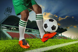 foot ball player holding foot ball on leg ankle on soccer sport