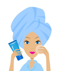 young woman with a towel on a head and tube of cream