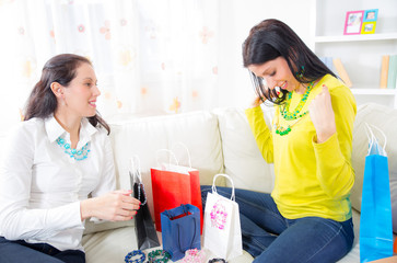 Two  women friends at home with  shopping bags and jewelry