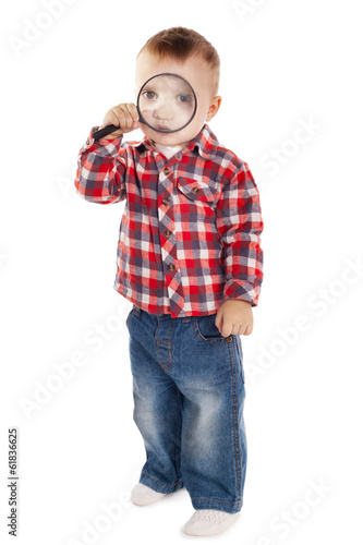 little boy with magnifier on white