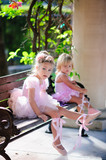 group of two little child ballerinas dress up their pointes