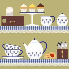 Tea set with teabag, cupcake and cookies