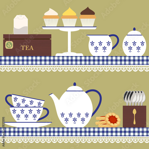 Tea set with teabag, cupcake and cookies