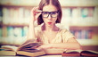 funny girl student with glasses reading books - 61838251