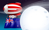A floating balloon with tne New Zealand flag
