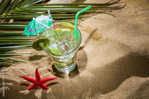 Kiwi cocktail on the sand
