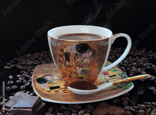 Cup of aromatic hot coffee with coffee beans