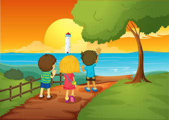 Three kids watching the lighthouse