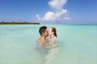 Couple kissing on a idyllic beach at Riviera Maya, Mexico