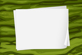 A green surface with empty papers