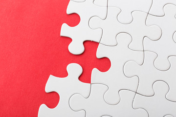 White puzzle on red background
