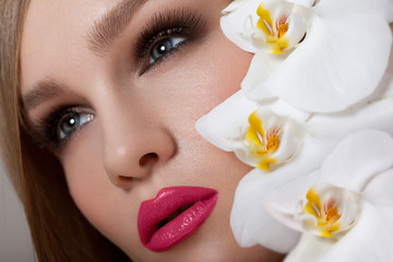 Makeup. Beautiful Woman With Red Lips and Long Eyelashes.