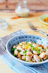 white beans with green onions, salad