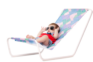 cute baby lying on lounger isolated on white