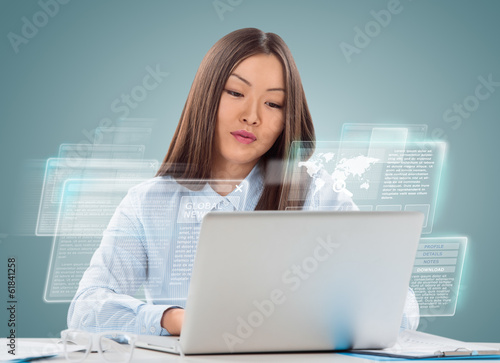 Attractive businesswoman against hightech background