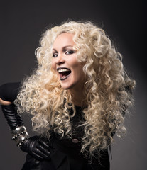 woman blonde curly hairs, surprised with open mouth black lips