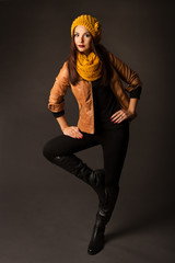 woman in season winter spring clothing posing in studio