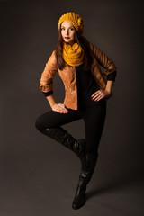 woman in season winter spring clothing posing in studio