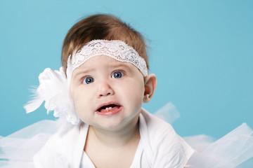 cute little ballerina on blue background