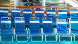 Blue and White Vinyl Chaise Lounges on Cruise Ship Deck