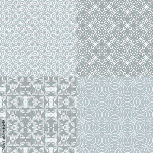 Set of 4 seamless grey geometric vector patterns.