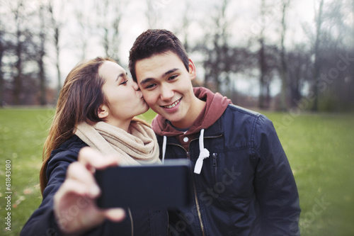 Loving teenage couple taking self portrait