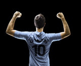 Uruguayan soccer player celebrates on black background
