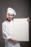 young chef holding a banner